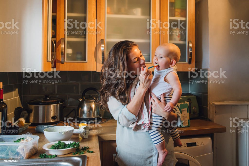 Feeding The Baby stock photo