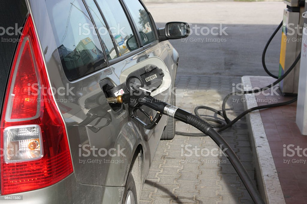 Feeding the car royalty-free stock photo