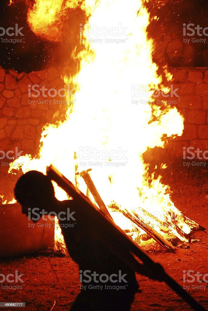 Feeding the fire. stock photo