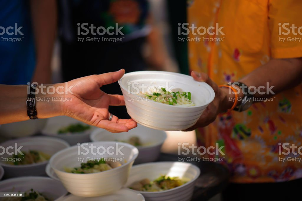 Feeding the poor to hands of a beggar. Poverty concept stock photo
