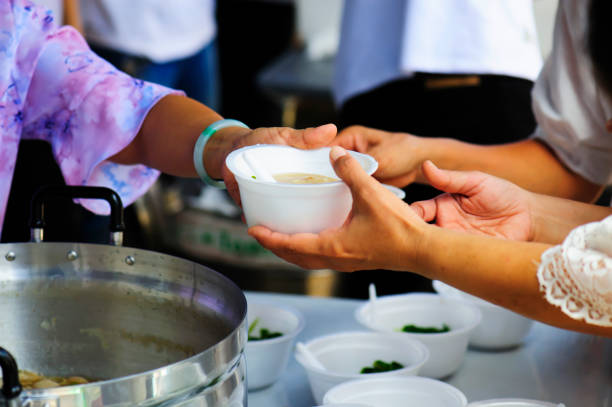 feeding the poor to help each other in society. charity concept - volunteer stock photos and pictures