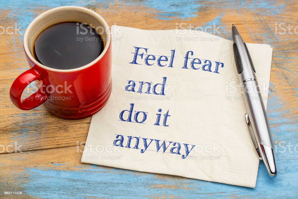 Feel fear and do it anyway - text on napkin stok fotoğrafı