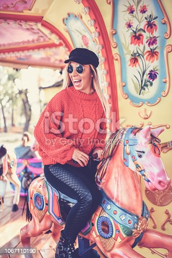 Cute Blonde Riding Horde On Marry Go Round