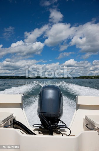Boating on a fine summer day along Maine coast under the stormy skies.