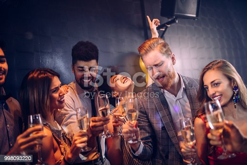 Group of friends having fun at the club