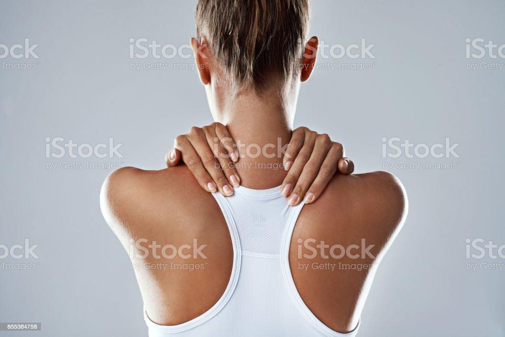 Feeling a little strain in her neck stock photo