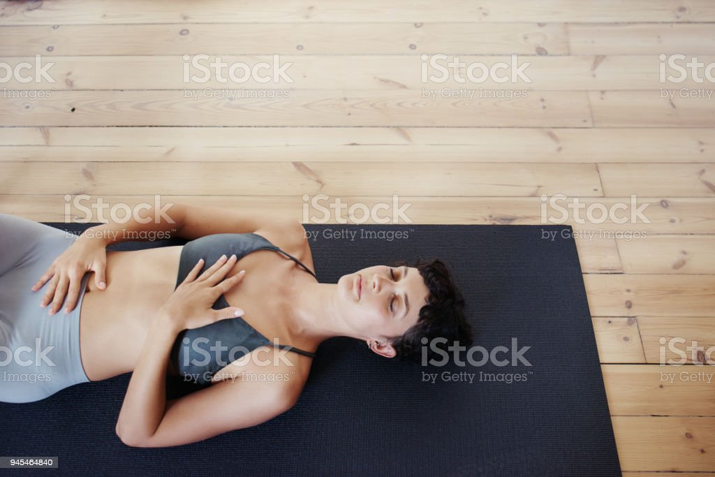Feeling calm and content after her yoga session stock photo