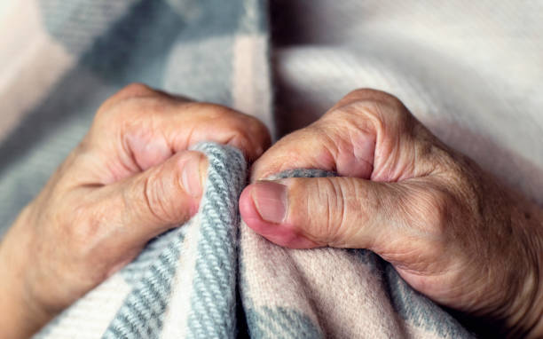 Feeling cold. Hands of elderly person feeling cold. stock photo