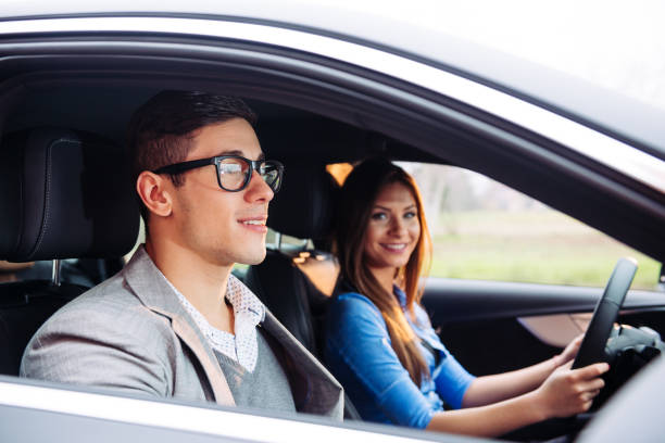 feeling confident with expert driving instructor - rideshare stock photos and pictures