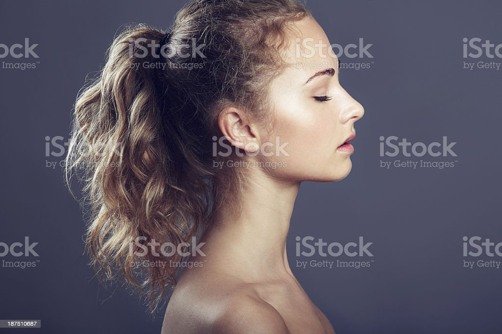 Feeling content with her haircare regime royalty-free stock photo