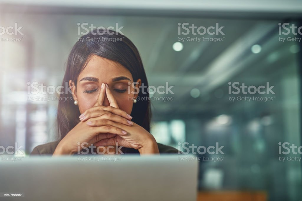 Feeling drained from all her efforts stock photo