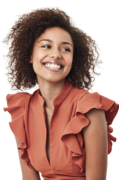 Feeling fantastic Studio shot of a cute young african american woman looking away and smiling looking away stock pictures, royalty-free photos & images