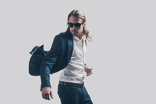feeling free and comfortable in his style. - lange jacken stock-fotos und bilder
