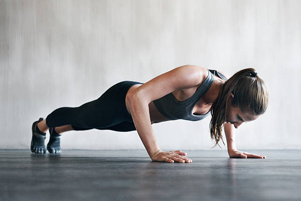 feeling good, looking great from working out regularly - push up stock photos and pictures