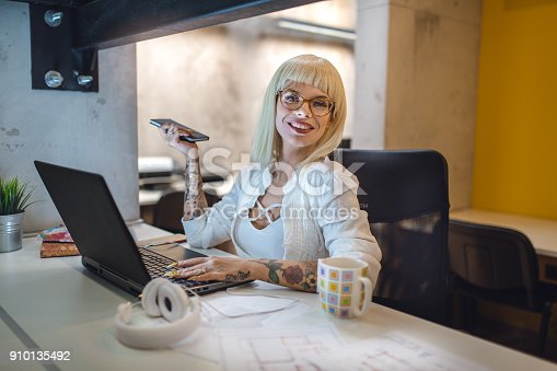 Young and beautiful modern businesswoman, working from home, in her home office.