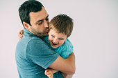 istock Feeling happy in dad's arms 1154847099