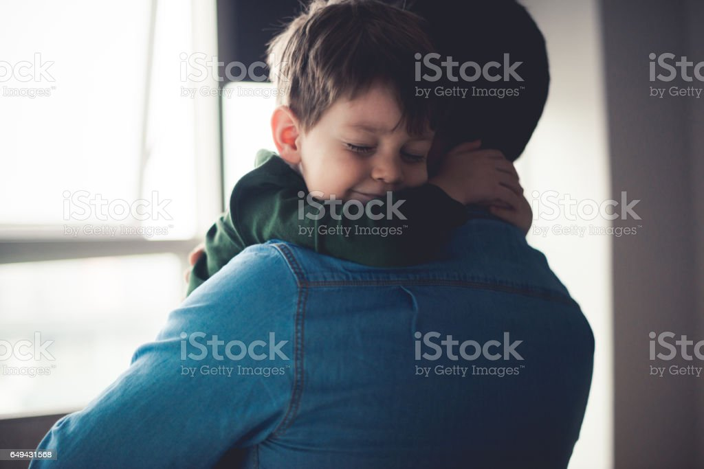 Feeling happy in dad's arms stock photo