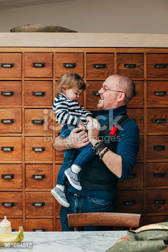649431568 istock photo Feeling Happy In Dad's Arms 951664512