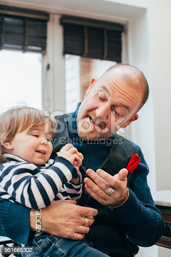 649431568 istock photo Feeling Happy In Dad's Arms 951665302