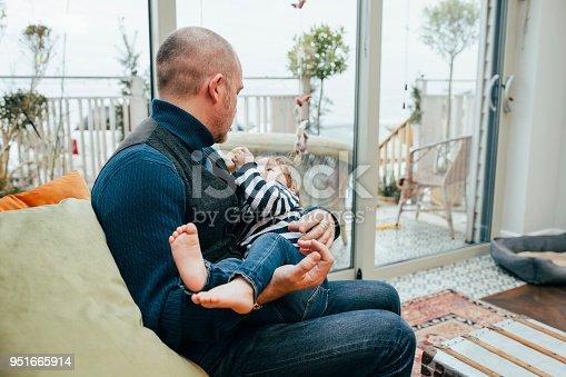 649431568 istock photo Feeling Happy In Dad's Arms 951665914