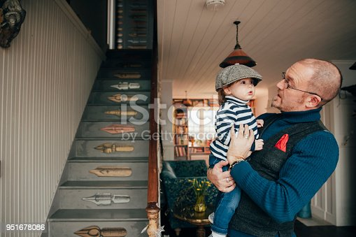 649431568 istock photo Feeling Happy In Dad's Arms 951678086