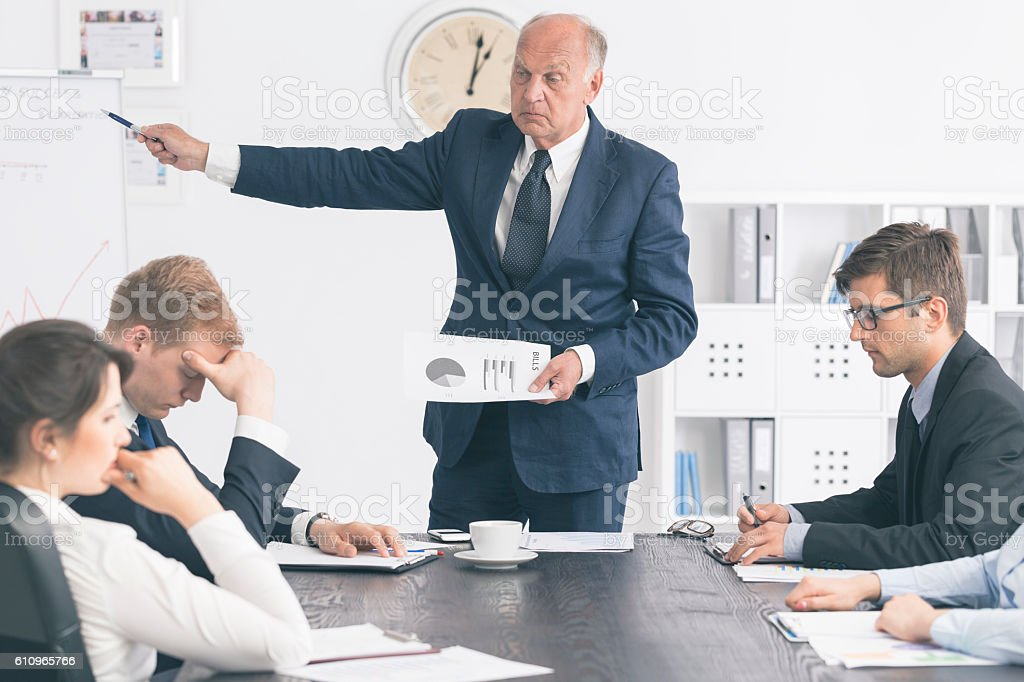 Feeling humiliated in front of colleagues stock photo