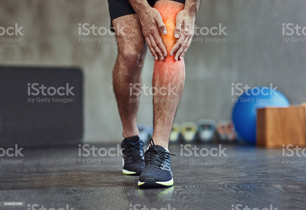 Feeling it in the knee stock photo