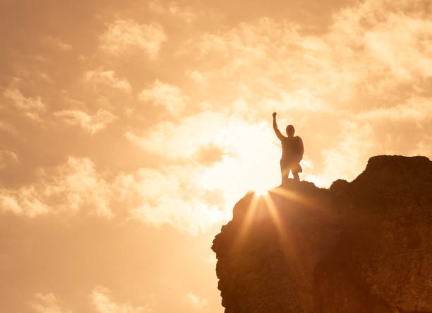 feeling like a winner! - conquering adversity stock photos and pictures