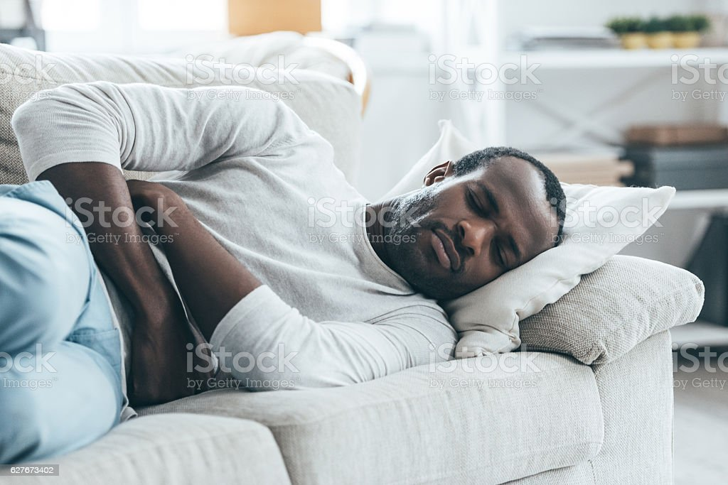Feeling stomachache. stock photo