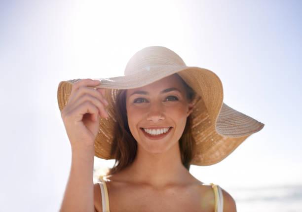 Feeling summery in her sunhat stock photo