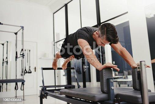 Shot of a mature man doing pilates