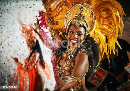 Cropped portrait of a beautiful samba dancer performing in a carnival with her band