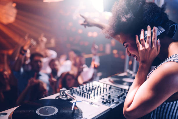 Feeling the music Young woman playing music at the club nightclub stock pictures, royalty-free photos & images