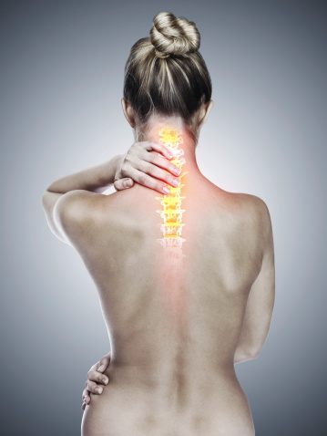 Rearview studio shot of a woman with back discomfort