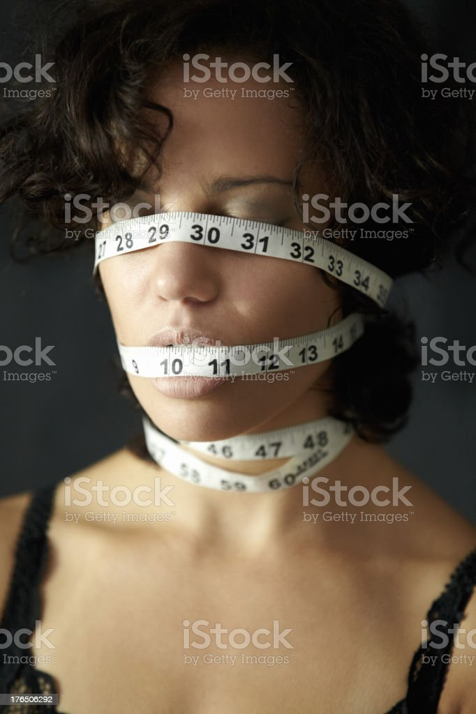 Feeling the pressure to be thin royalty-free stock photo