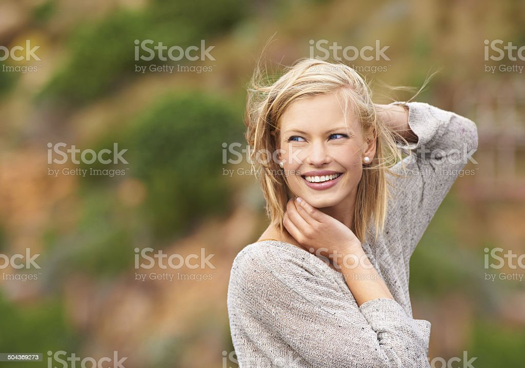 Feeling the wind in her hair stock photo