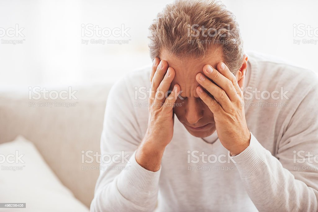 Feeling tired and depressed. stock photo