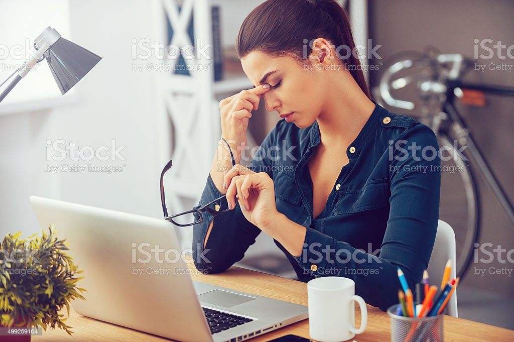 Feeling tired and stressed. stock photo