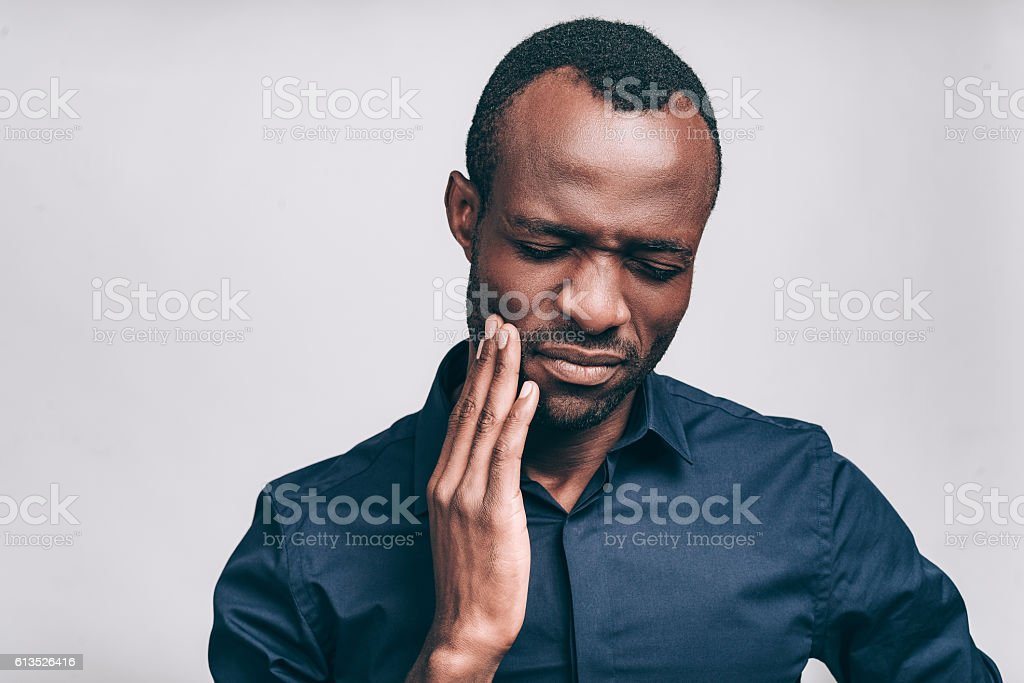 Feeling toothache. stock photo