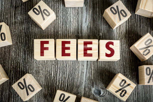 Fees sign Wooden Blocks with the text: Fees fee stock pictures, royalty-free photos & images