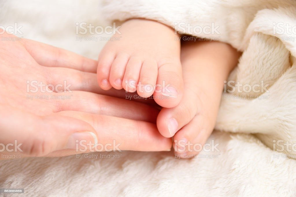 feet a size tiny! stock photo