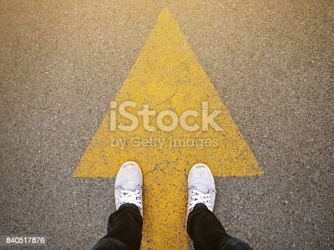 istock Feet and arrows on road 840517876