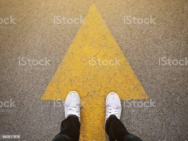 Feet and arrows on road picture id840517876?b=1&k=6&m=840517876&s=612x612&h=qjukocotbztizglie7pnkc3wxtyg 3i9i4hmbdocbie=