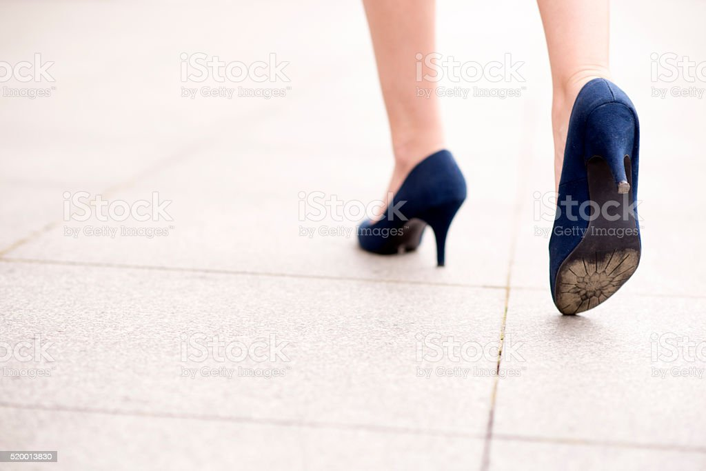 Feet and legs of woman walking stock photo