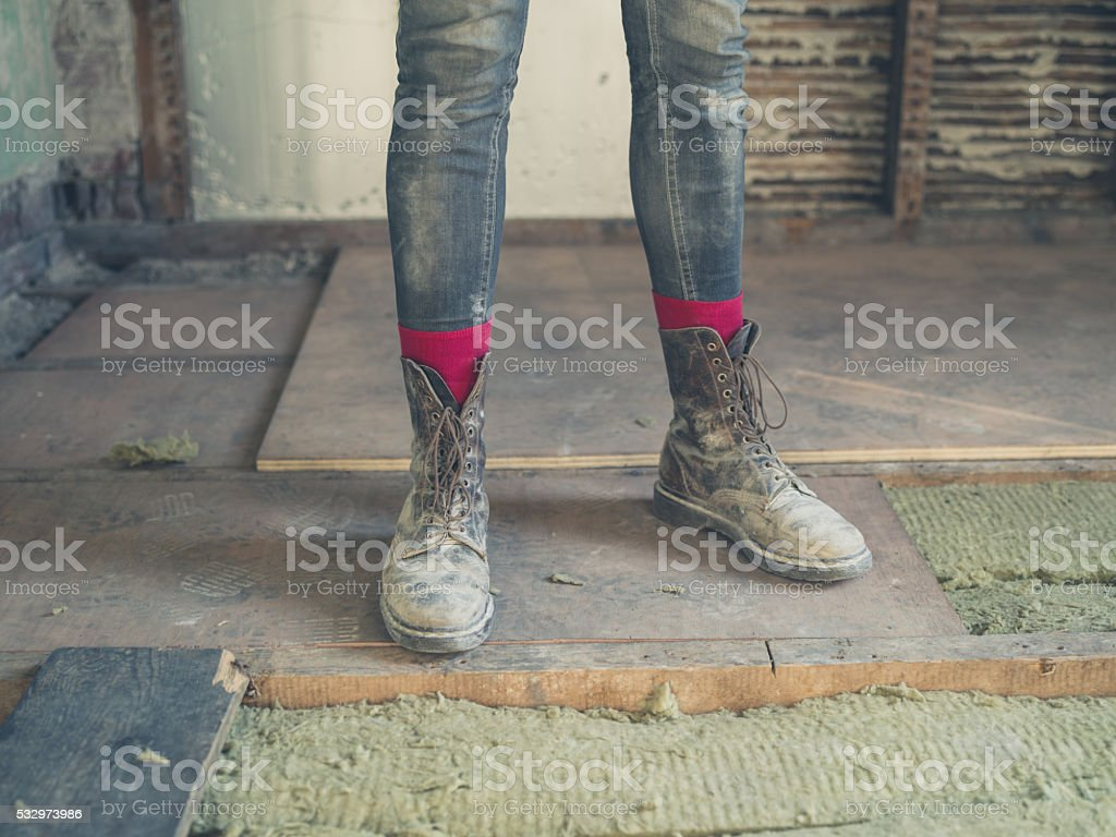 Feet and legs of worker by insulation stock photo