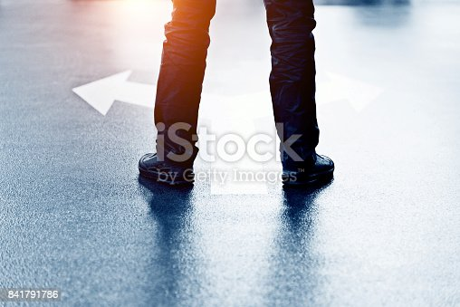 istock Feet and two arrows painted on floor 841791786