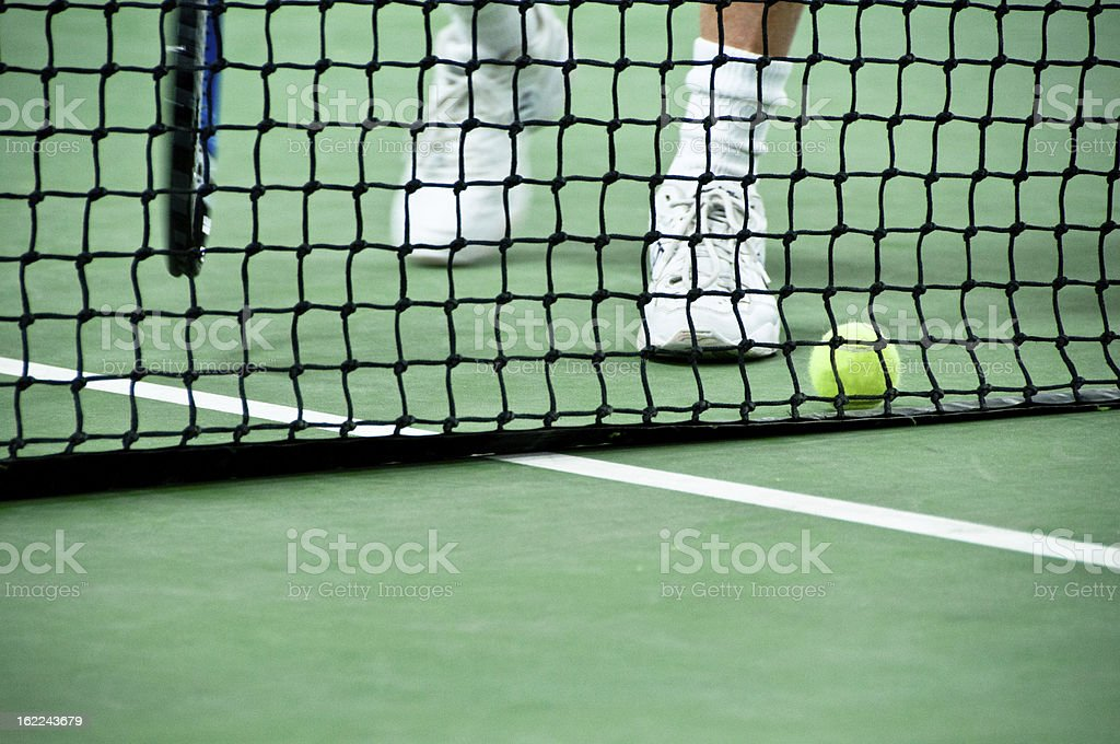 Feet approaching a ball on the tennis court stock photo