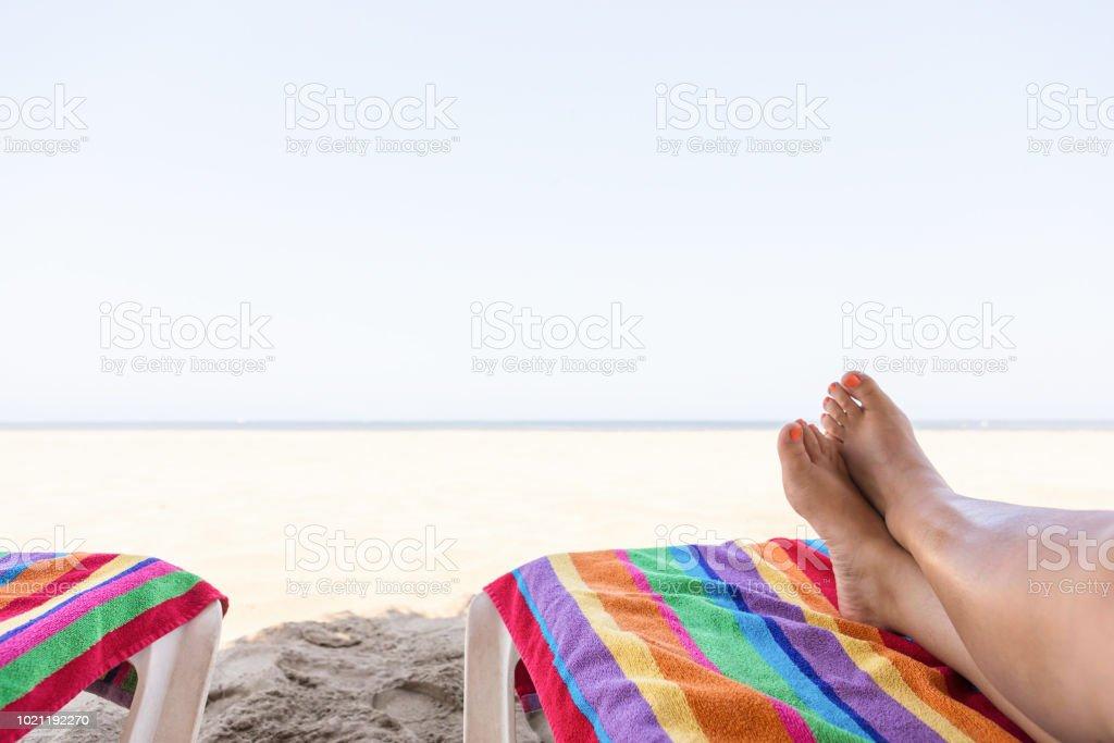 feet at the beach stock photo