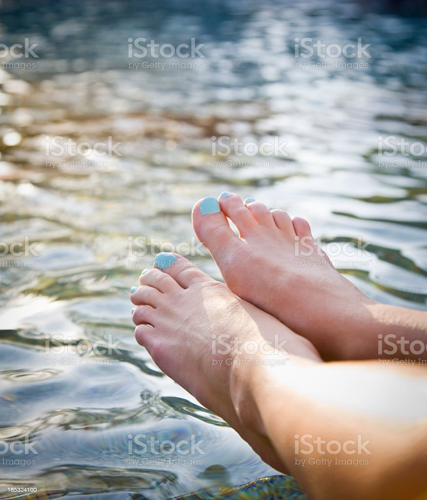 Feet by water royalty-free stock photo