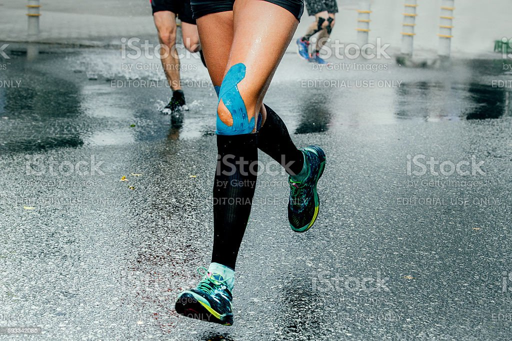 feet girl runners in compression sock stock photo